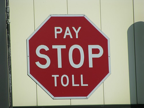 stop sign that says stop pay toll